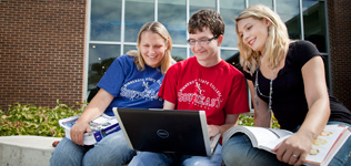Students Outside with Computer