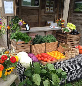 Farm stand with flowers and vegetables